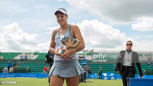 Ana Konjuh of Croatia walks off court with the Elena Baltacha Trophy on day eight of the WTA Aegon Open Nottingham at Nottingham Tennis Centre on...