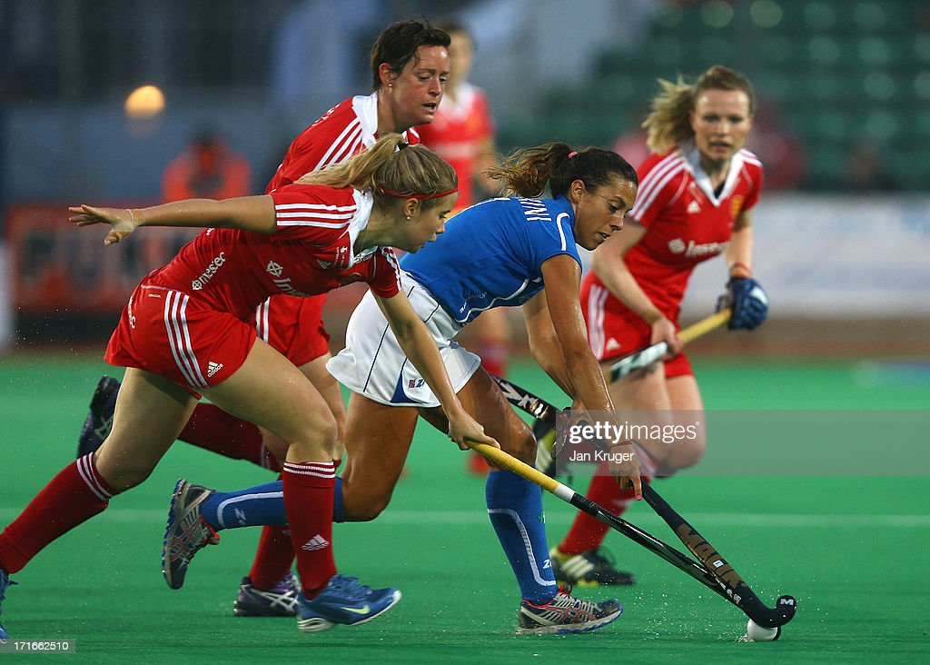 Ana Laura Bertarini of Italy cuts through the England defence during the Investec Hockey World League quarterfinal match between England and Italy at the Quintin Hogg Memorial Sports Grounds on June 27, 2013 in London, England.