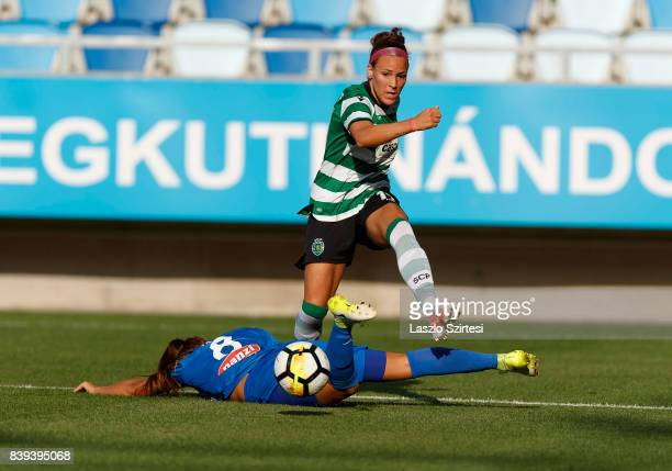 Ana Leite of Sporting CP crosses the ball next to Barbara Toth of MTK Hungaria FC during the UEFA Women's Champions League Qualifying match between...