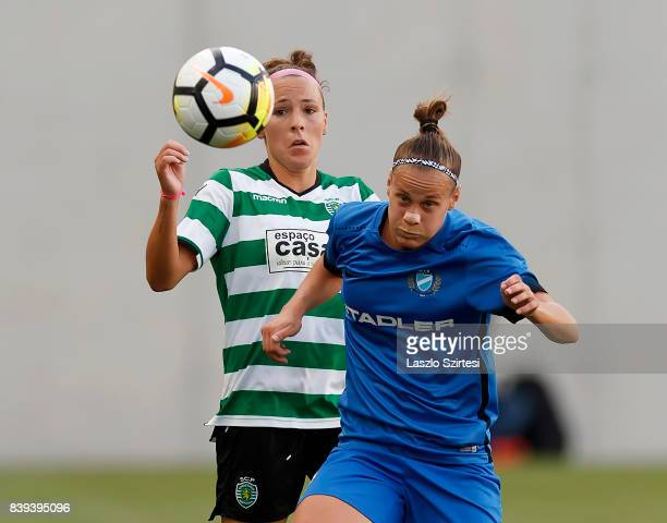 Ana Leite of Sporting CP duels for the ball with Dora Papp of MTK Hungaria FC during the UEFA Women's Champions League Qualifying match between...