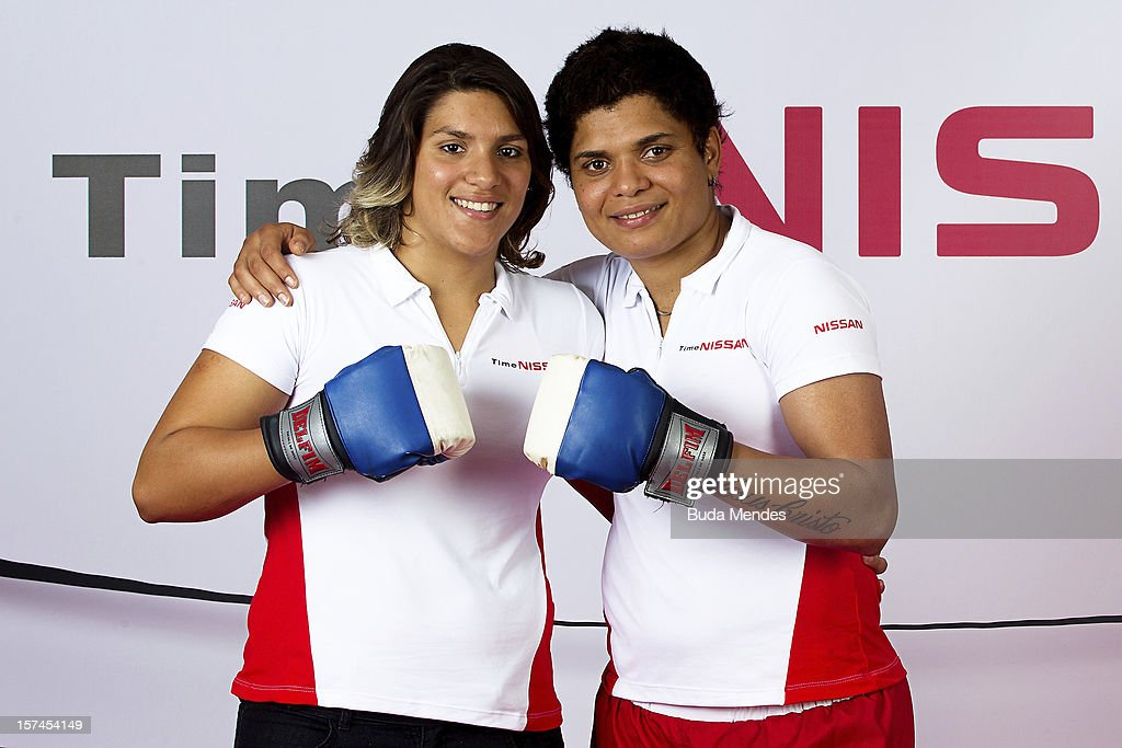 Ana Marcela (L) and <a gi-track='captionPersonalityLinkClicked' href=/galleries/search?phrase=Adriana+Araujo&family=editorial&specificpeople=6872072 ng-click='$event.stopPropagation()'>Adriana Araujo</a> (R) pose for a picture during the presentation of Team Nissan for Rio de Janeiro Olympics Games 2016 at Cine Lagoon on November 27, 2012 in Rio de Janeiro, Brazil.
