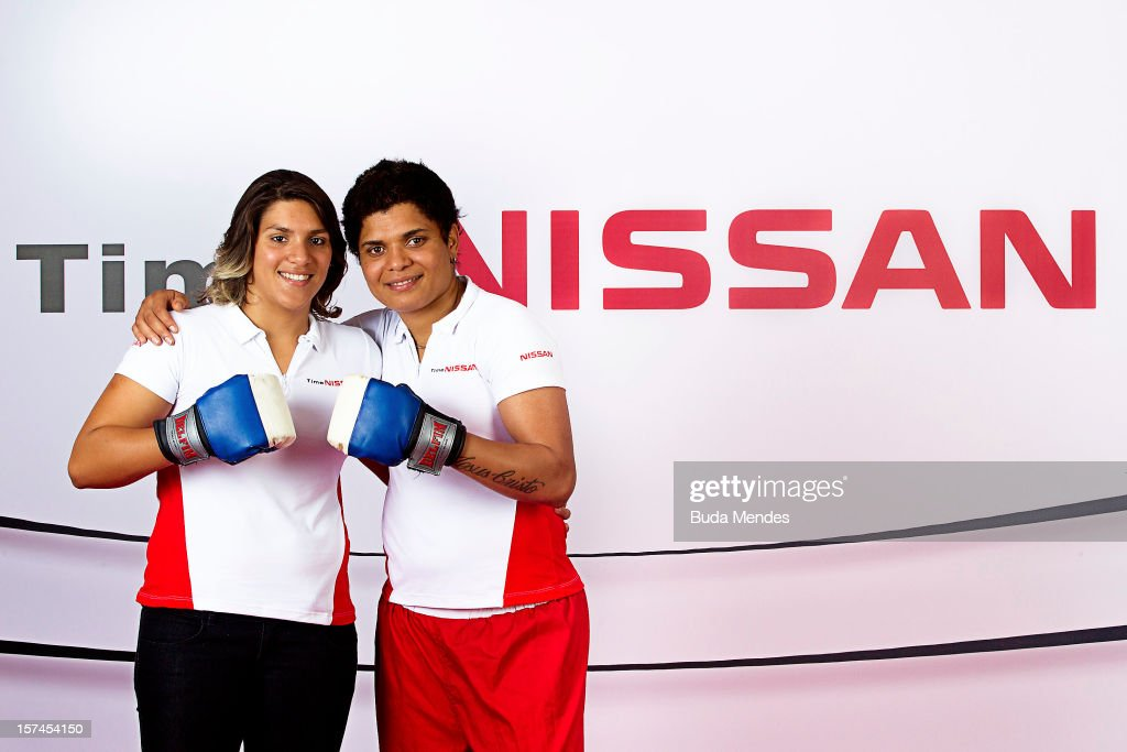 Ana Marcela (L) and Adriana Araujo (R) pose for a picture during the presentation of Team Nissan for Rio de Janeiro Olympics Games 2016 at Cine Lagoon on November 27, 2012 in Rio de Janeiro, Brazil.