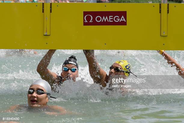 Ana Marcela Cunha of Brazil and Arianna Bridi of Italy touch together for third place in the Women's 10km Open Water Swimming on day three of the...
