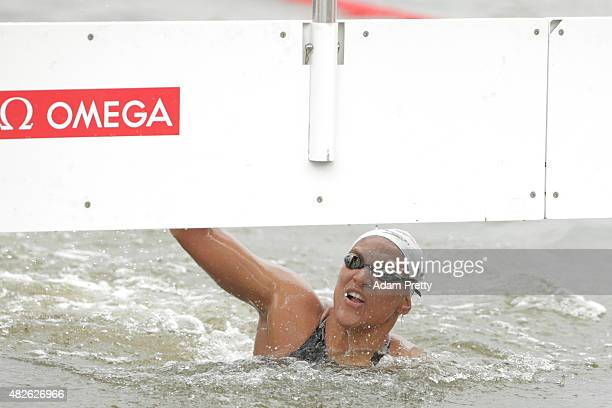 Ana Marcela Cunha of Brazil celebrates winning the gold medal in the Women's 25km Open Water Swimming Final on day eight of the 16th FINA World...