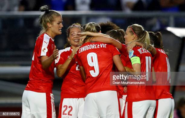 Ana Maria Crnogorcevic of Switzerland celebrate with her teammates after she heads the opening goal during the Group C match between Switzerland and...