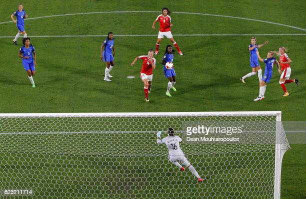 Ana Maria Crnogorcevic of Switzerland heads the opening goal over Sarah Bouhaddi goalkeeper of France during the Group C match between Switzerland...