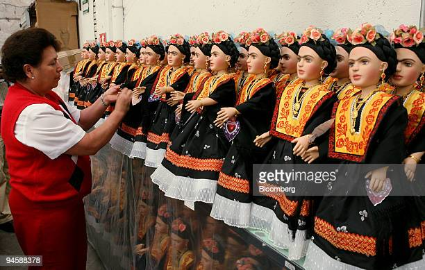 Ana Maria inspects finished Frida Kahlo dolls at a production company in Mexico City Mexico on May 18 2007 In July Mexico will celebrate what would...
