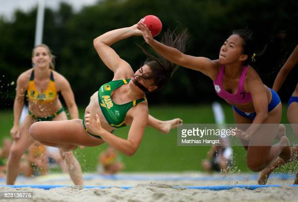 Ana Medjed of Australia is challenged by NienEn Hsieh of Chinese Taipei during the Beach Handball Women's Group B match between Australia and Chinese...