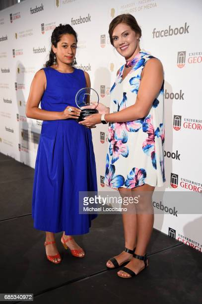Ana Naomi de Sousa accepts an award from Shelby Silverman on behalf of Saydnaya at the PeabodyFacebook Futures Of Media Awards at Hotel Eventi on May...