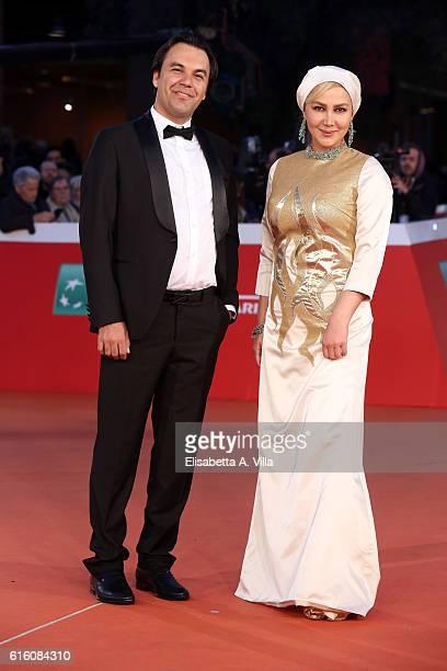Ana Nemati and Mehdi Fard Ghaderi walk a red carpet for 'Javdanegi Immortality' during the 11th Rome Film Festival at Auditorium Parco Della Musica...