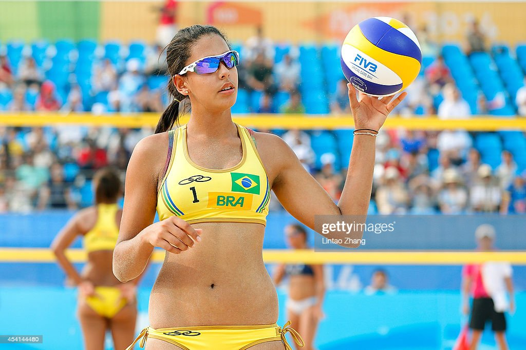 Ana Patricia Silva (L) and Eduarda Lisboa of Brazil play Camila Hiruela Tapia and Irene Verasio of Argentina to determine women's Beach Volleyball Quarterfinal on day nine of Nanjing 2014 Summer Youth Olympic Games at Sports Park Beach Volley Venue on August 25, 2014 in Nanjing, China.