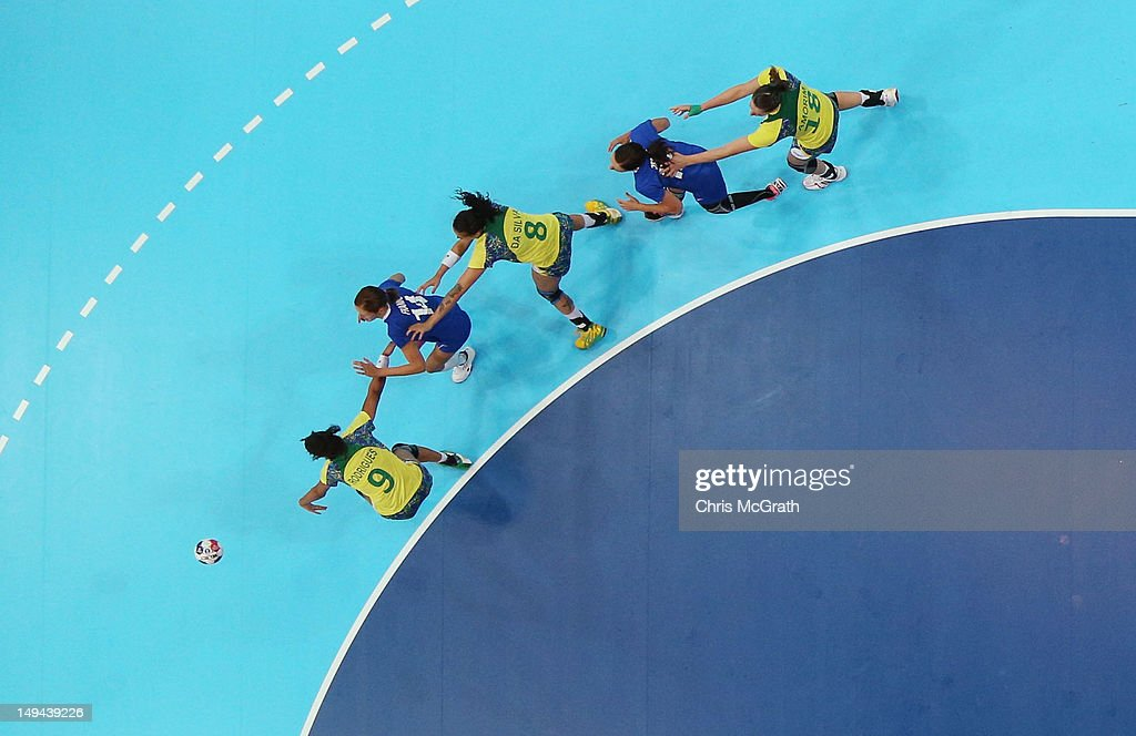 Ana Paula Rodrigues of Brazil and Kristina Franic of Croatia battle for the ball in the Women's Handball preliminaries Group A - Match 3 between Croatia and Brazil on Day 1 of the London 2012 Olympic Games at the Copper Box on July 28, 2012 in London, England.