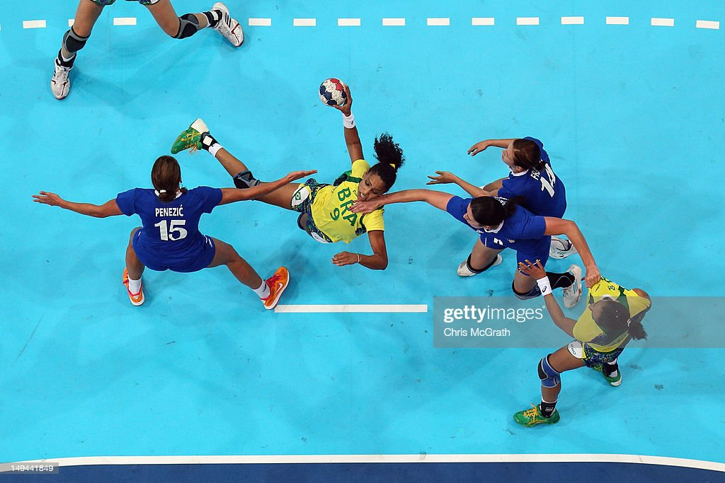 Ana Paula Rodrigues of Brazil attacks in the Women's Handball preliminaries Group A - Match 3 between Croatia and Brazil on Day 1 of the London 2012 Olympic Games at the Copper Box on July 28, 2012 in London, England.