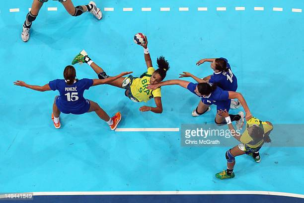 Ana Paula Rodrigues of Brazil attacks in the Women's Handball preliminaries Group A Match 3 between Croatia and Brazil on Day 1 of the London 2012...