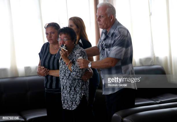 Ana Ruiz is escorted out by family members as they head to the cemetery in Corozal Puerto Rico on Oct 02 2017 After Hurricane Maria Ruiz used his...