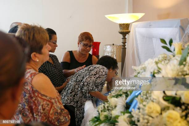 Ana Ruiz leans over to kiss her husband's forehead during his wake in Corozal Puerto Rico on Oct 02 2017 After Hurricane Maria Ruiz used his car's...