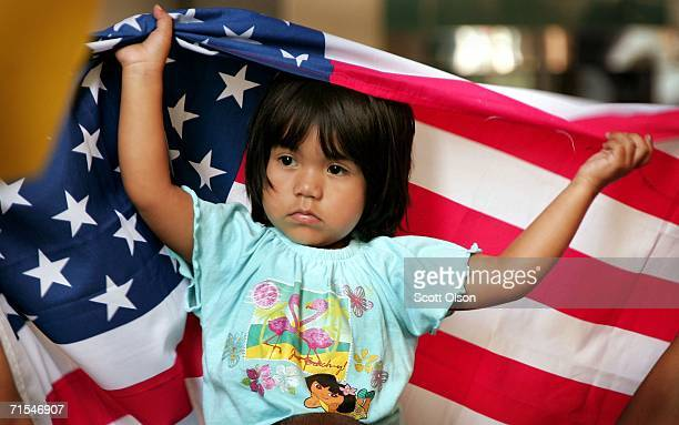 Ana Sari sits on her father's shoulders as they demonstrate outside the building that houses immigration court along with family and friends of IFCO...