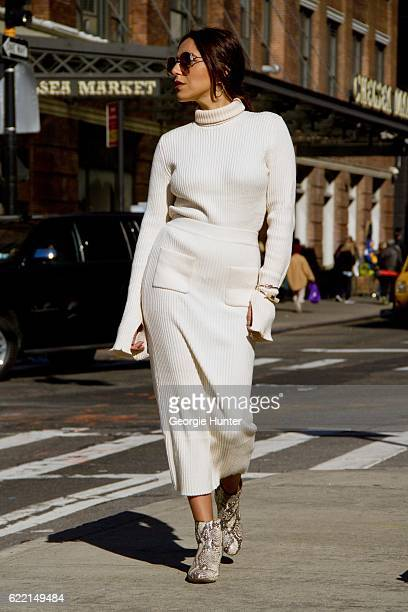 Ana Sousa wearing Ecru white ribbed knit sweater with polo neck and long sleeves with slit from Zara white midi high waisted Ecru ribbed knit pencil...