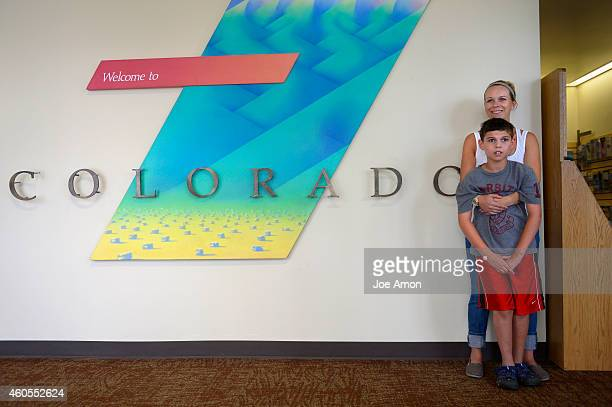 Ana Watson and son Preston stopped to take a picture after entering what they hope will be a breakthrough in their quest for seizure control in...