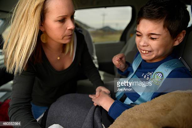 Ana Watson keeps a sharp eye as her 12yearold son Preston goes into a grand mal seizure on the frontage road near Mile Marker 174 on Interstate 25 on...