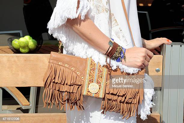 Ana wears Raceu hat a Monica Lendinez Kaftan a Zarass sandals Nuna Bascon Bcn basics bracelets a Just Cavalli handbag and a Baprincess collar during...