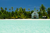 A church on the white sand beach in atoll Anaa, French Polynesia - part of the Tuamotu Archipelago