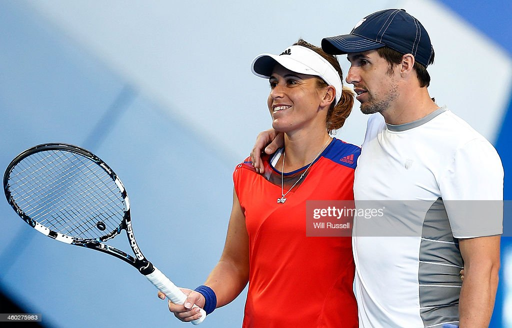 <a gi-track='captionPersonalityLinkClicked' href=/galleries/search?phrase=Anabel+Medina+Garrigues&family=editorial&specificpeople=595904 ng-click='$event.stopPropagation()'>Anabel Medina Garrigues</a> and Daniel Munoz-De La Nava of Spain talk between serves in the mixed doubles match against Alize Cornet and Jo-Wilfried Tsonga of France during day seven of the Hopman Cup at Perth Arena on January 3, 2014 in Perth, Australia.