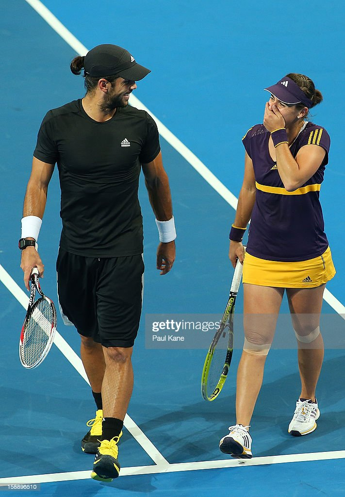 Anabel Medina Garrigues and Fernando Verdasco of Spain discuss tactics in the mixed doubles match against Venus Williams of the USA and Thanasi Kakkinakis of Australia during day six of the Hopman Cup at Perth Arena on January 3, 2013 in Perth, Australia. Thanasi Kakkinakis, the number 2 ranked 16 year old player in the world, replaced John Isner of the USA after withdrawing from the event due to injury.