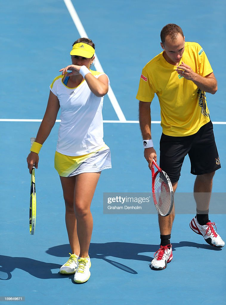 Anabel Medina Garrigues of Spain and Bruno Soares of Brazil talk tactics in their mixed doubles first round match against Bojana Bobusic of Australia and Chris Guccione of Australia during day five of the 2013 Australian Open at Melbourne Park on January 18, 2013 in Melbourne, Australia.
