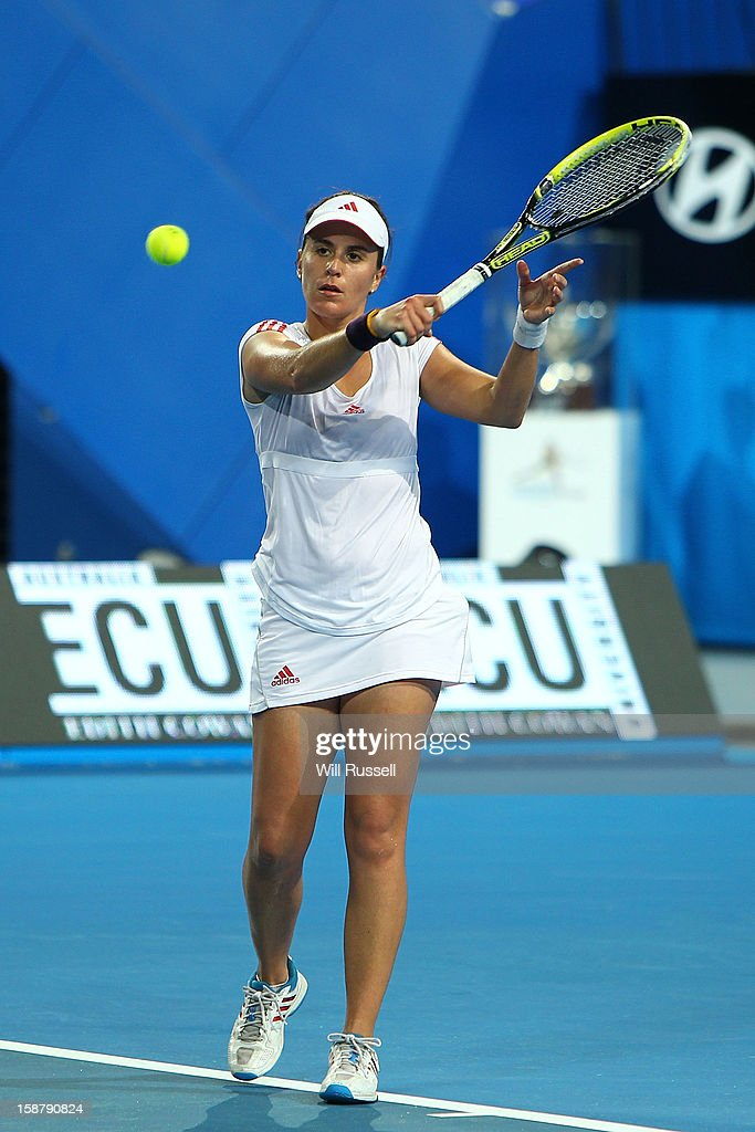 <a gi-track='captionPersonalityLinkClicked' href=/galleries/search?phrase=Anabel+Medina+Garrigues&family=editorial&specificpeople=595904 ng-click='$event.stopPropagation()'>Anabel Medina Garrigues</a> of Spain hits a backhand shot in her singles match against Chanelle Scheepers of South Africa during day one of the Hopman Cup at Perth Arena on December 29, 2012 in Perth, Australia.