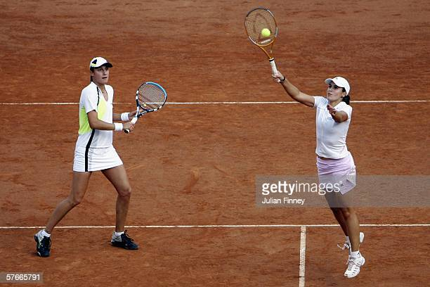 Anabel Medina Garrigues of Spain plays a volley as partner Katerina Srebotnik of Slovenia watches in their match against Kveta Peschke of Czech...