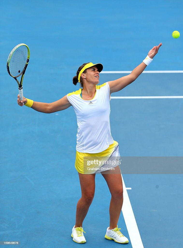 Anabel Medina Garrigues of Spain serves in her mixed doubles first round match with Bruno Soares of Brazil against Bojana Bobusic of Australia and Chris Guccione of Australia during day five of the 2013 Australian Open at Melbourne Park on January 18, 2013 in Melbourne, Australia.