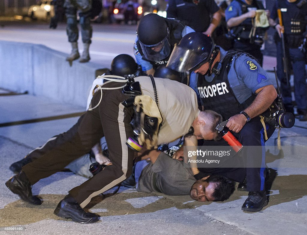 Anadolu Agency's correspondent in the U.S Bilgin Sasmaz is taken into custody by polices while he was covering protests in Ferguson, Missouri over the killing of an unarmed black teenager in United States on August 20, 2014. Bilgin Sasmaz is released after remaining in detention for 5 hours.