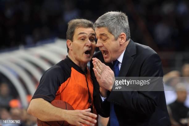 Anadolu Efes' coach Oktay Mahmuti reacts as he complains to a referee during the Euroleague basketball match Anadolu Efes vs Real Madrid on February...