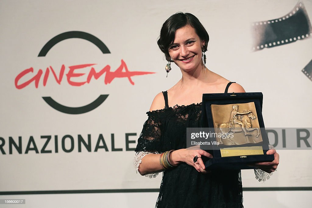 Ana-Felicia Scutelnicu poses with her CinemaXXi Award for Short and Medium Film during the Award Winners Photocall during the 7th Rome Film Festival at Auditorium Parco Della Musica on November 17, 2012 in Rome, Italy.
