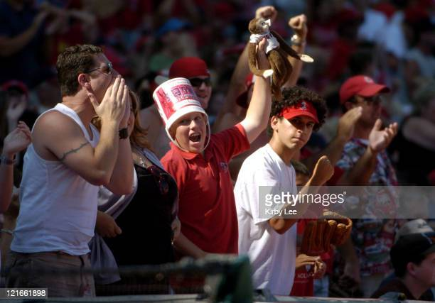 Anaheim Angel fan with Rally Monkey cheers during 20 loss to the Texas Rangers at Angel Stadium in Anaheim Calif on September 18 2004