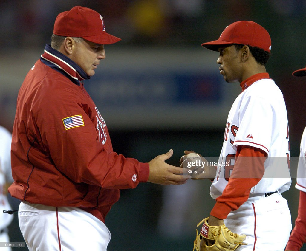 Anaheim Angels manager Mike Scioscia removes starting pitcher Ramon Ortiz in the third inning against the Texas Rangers at Angel Stadium on Tuesday, April 20, 2004. Ortiz allowed six hits and four runs in 2 1/3 innings.