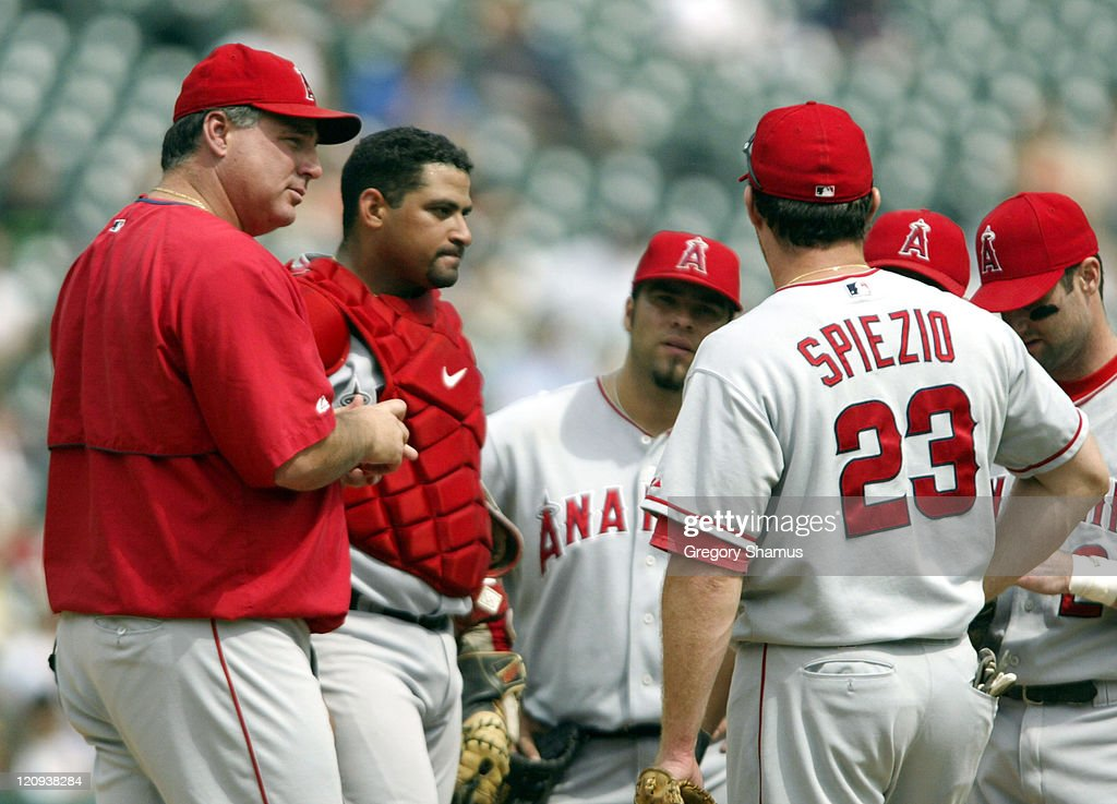 Anaheim Angels manager Mike Scioscia (L) talks with Scott Spiezio (R) and the rest of the Anaheim infield after replacing starting pitcher Scot Shields with Greg Jones in the fifth inning during a game with the Detroit Tigers. Detroit won the game 10-9.