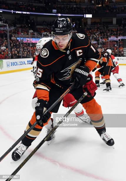 Anaheim Ducks captain Ryan Getzlaf fights for the puck next to the boards in the first period of a game against the Carolina Hurricanes on December...