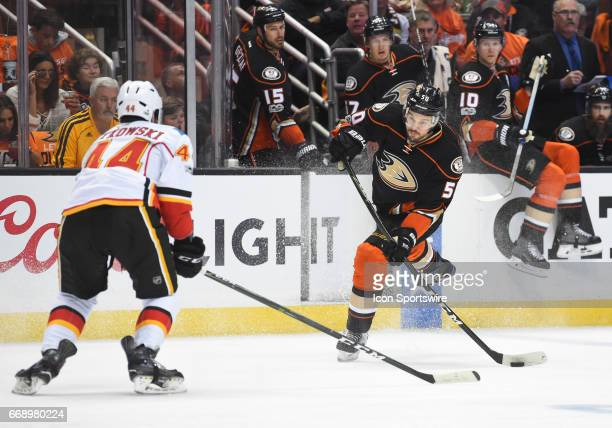 Anaheim Ducks Center Antoine Vermette takes a shot from near the blue line that is blocked by Calgary Flames Defenceman Matt Bartkowski during game 2...