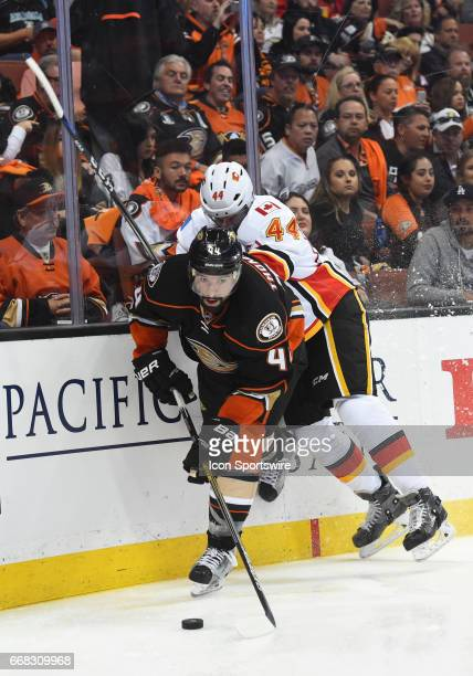 Anaheim Ducks Center Nate Thompson escapes a check by Calgary Flames Defenceman Matt Bartkowski during game 1 of the first round of the 2017 NHL...