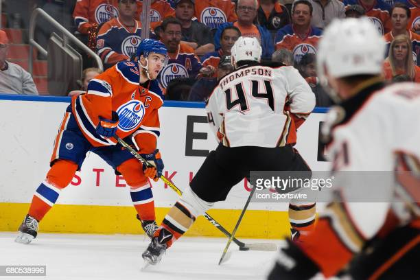 Anaheim Ducks Center Nate Thompson looking to steal the puck away from Edmonton Oilers Center Connor McDavid before he can pass it on May 07 2017 at...