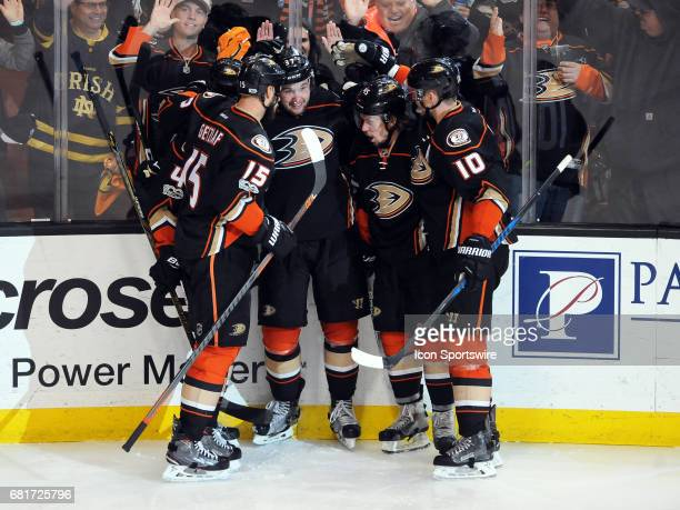 Anaheim Ducks center Rickard Rakell is surrounded by his teammates after Rakell scored the go ahead goal in the third period of game 7 of the second...