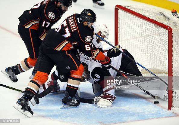 Anaheim Ducks center Rickard Rakell pushes the puck over the line under Arizona Coyotes goalie Justin Peters leg in the third period of a game...