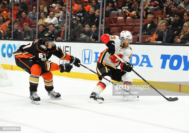 Anaheim Ducks Center Rickard Rakell tries to steal the puck away from Calgary Flames Center Sam Bennett during an NHL game between the Calgary Flames...