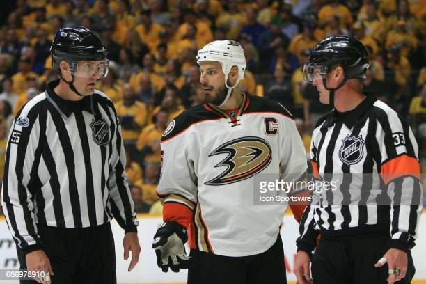 Anaheim Ducks center Ryan Getzlaf talks with referee Kevin Pollock and linesman Shane Heyer during Game 6 of the Western Conference Final between the...