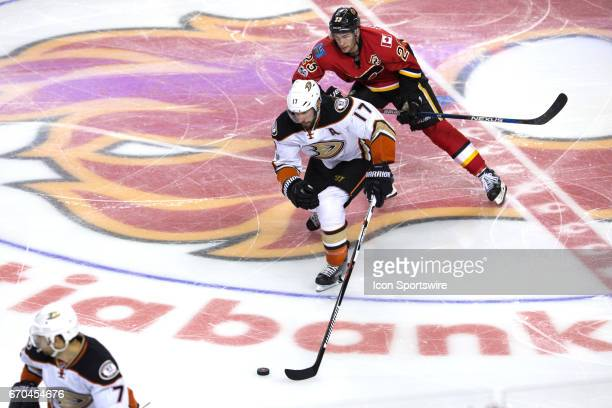 Anaheim Ducks Center Ryan Kesler is chased through center ice by of the Calgary Flames Center Sean Monahan during game 4 of the first round of the...
