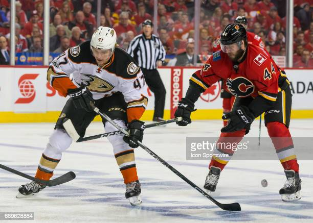 Anaheim Ducks Defenceman Hampus Lindholm makes a backhand pass under the legs of Calgary Flames Defenceman Matt Bartkowski during a game during game...