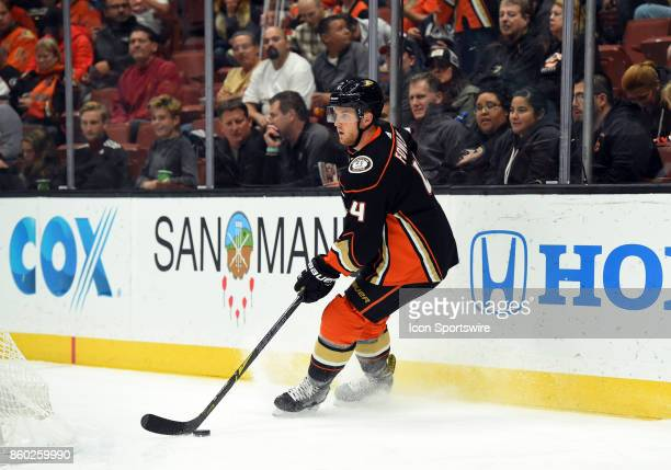 Anaheim Ducks Defenseman Cam Fowler brings the puck out from behind the net during an NHL game between the Calgary Flames and the Anaheim Ducks on...