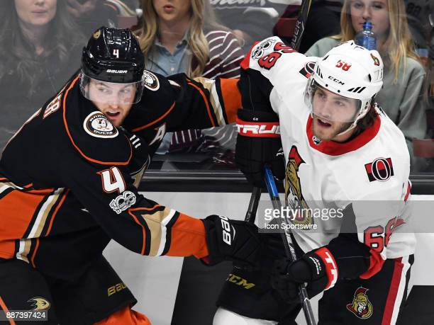Anaheim Ducks defenseman Cam Fowler in action with Ottawa Senators leftwing Mike Hoffma in the second period of a game played on December 6 2017 at...